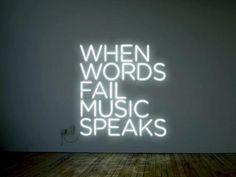 'When words fail music speaks' Neon