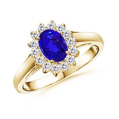 I LOVE the blue tanzanite in this ring :) So gorgeous and different!