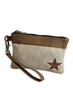 """This practical leather and canvas wristlet features a blackinterior with a brown leather divided credit card holder. Top brass zip and hardware. Leather wrist band and trim. Perfect to hold your cell phone money cards and keys!  Dimensions:6"""" x 4""""  Star Wristlet by Pine Creek. Bags - Wallets & Wristlets Tampa Florida"""