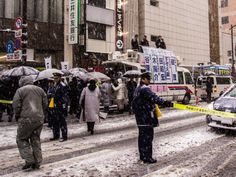 From my blog about Japan (Nihon Arekore): politicians rallying in Asakusa's Kaminarimon Dori/Street last Saturday while the blizzard was raging...