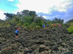Lava fields dotted with some green and some blue above. On the way to Wreck Bay is tricky terrain but well worth the destination.  - Rangitoto Island Auckland NZ  - HTC Desire Eye  - Snapseed