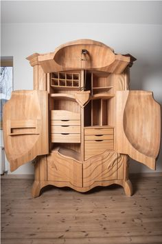1573871 Extraordinary Beetle Closet by Janis Straupe. Whoa! I'm not sure I'd want a giant beetle in my room, but look at all the little boxes and drawers!