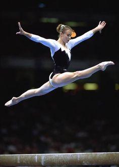 Svetlana Boguinskaya (Belarus) doing a split leap on the balance beam