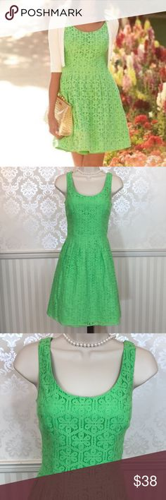 """Lilly Pulitzer Green Posey Daisy Lane Dress Lilly Pulitzer Posey sleeveless fit & flare dress in excellent condition.  Lovely green color.  This special edition Lilly lace and a full circle skirt make this dress a must-have-addition for your wardrobe. Feminine scoop neckline, with scoop back.  Pleated full skirt.  Concealed back zipper.  Fully lined. Pair with a skinny belt for added flair.  Bust is about 32,"""" length is approximately 33."""" Shell is 100% cotton, 40% nylon; lining is 100%…"""