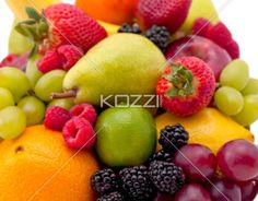 fresh fruit - An arrangement of Berries, Apples, Grapes, Pears, Lime and Oranges.