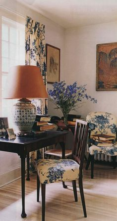 Sweet corner, but it would be cozier if the wall color was a few shades darker...love the dark wood, curtains, lamp (Mrs. Blandings)