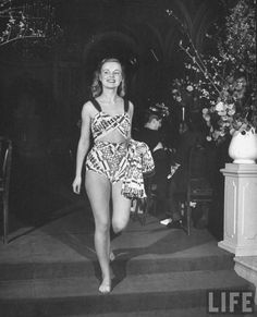 A teenager modeling a bathing suit designed by Emily Wilkens, 1946, Photographed by Herbert Gehr