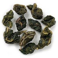 """The Republic of Tea - hand-processed green oolong is grown high in the Fujian mountains in China. Famous for its """"milky"""" taste and silky texture, the large, tightly-rolled leaves have the alluring fragrance of sweet cream and pineapple. The flavor is smooth with light, orchid notes."""