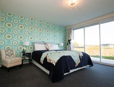 Bright wallpaper feature to bring personality to the space