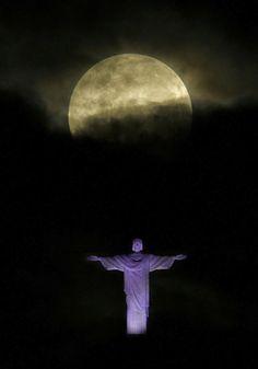 Supermoon above the Christ the Redeemer Statue, Rio de Janeiro, Brazil.  5-5-2012