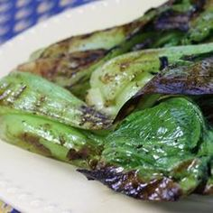 Grilled Bok Choy | Bok choy is brushed with seasoned butter as it grills, for grill marks on the tender stems and crispy leaf edges. It's a different and tasty vegetable side for your grilled main dish.
