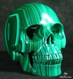Malachite skull. Malachite creates a toxic gas if put into a jewelers pickling solution.
