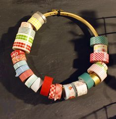 use the outer ring of an embroidery hoop to store washi tape rolls