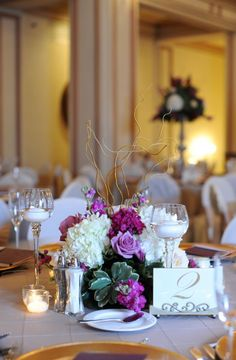 low purple centerpiece with greenery