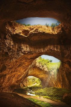 Devetashka Cave, Bulgaria. Devetashka cave is located 15 km (9.3 mi) northeast of Lovech and approximately 2 km (1.2 mi) from the village of Devetaki. Devetàshka cave is huge karst cave in Bulgaria, known for its long term occupancy for human and other type biological populations during extensive historical periods. It is also home to nearly 30,000 bats.