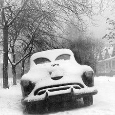 Chicago Snow in 40s, vintage car makes face with wipers