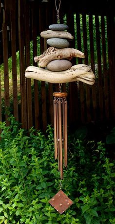 A natural Pacific beach stone and driftwood wind chime- naturally beautiful. This wind chime measures about 47 inches long from the top of the copper hook to the bottom of the windsail. The driftwood