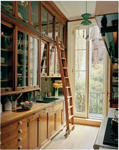 library-like lower cabinet drawers, glass doors on all upper cabinets