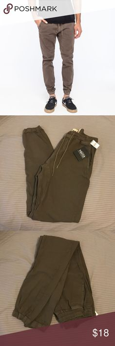 House of Triot Twill Jogger Pants - Slant front pockets - Button welt back pocket - Elastic drawstring waist - Elastic leg openings  - 97% cotton/3% spandex House of Triot Pants Sweatpants & Joggers