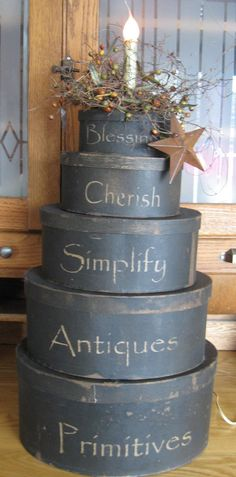Primitive stacking hat boxes repurposed into electric lighting available on Ebay