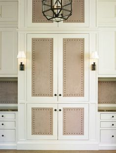 Suede paneled doors with French brass tacks. Suede paneled doors with French brass tacks. Ivory Kitchen Cabinets, Bathroom Cabinets, Hill Interiors, Exterior Doors, Rustic Exterior, Closet Doors, Hall Closet, Panel Doors, Built Ins