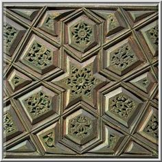 Carved wood panel with a geometric pattern on display in Museum of Islamic Art. Doha, Qatar