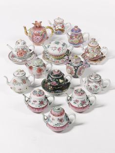 A COLLECTION OF FOURTEEN COLOURFUL CHINESE TEAPOTS QING DYNASTY, QIANLONG PERIOD (1736-1795) AND LATER