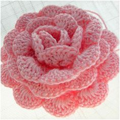 "Perfect stitch for flower motif to decor homes, as a gift for friends. This project is pretty well described with instruction and materials - how to crochet crochet flower, which number of hook to use. Three rows and alterations of ""crochet rose"" will see on video and read from pattern below. Don't iritate this free pattern is below. Share your final work in our facebook group. This pattern is available totally for free in below: More free crochet patterns? join our facebook g..."
