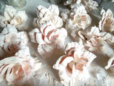 "Get ""ceramic"" looking flowers by dipping inexpensive silk flowers (found at the dollar store or goodwill) in plaster."