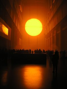 Olafur Eliasson: The Weather Project Installation creates an ethereal space through the use of light and shadow.