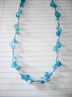 Now this one was really simple. I started with 3 strands .14 gauge colored wire then I put a bead on each strand and then slipped a single clear bead over all 3. Then I just repeated the process over again. It kind of reminds me of Bubbles.... :-)
