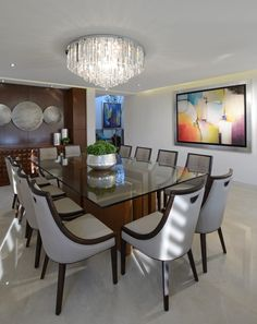 Busca imágenes de Comedores de estilo moderno en beige: Comedor Casa GL. Encuentra las mejores fotos para inspirarte y crea tu hogar perfecto.