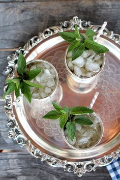 Classic kentucky mint julep  25–30 mint leaves + 2.5 ounces of bourbon + 1 ounce of  simple syrup + ice + one big shake  = the perfect mint julep to strain over crushed ice