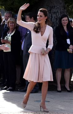Kate Middleton in Alexander McQueen The Duchess showed up in Adelaide in a blush pink V-neck, three-quarter-length sleeve top and matching pleated knee-length skirt from Alexander McQueen. Simple jewelry (including pink pearl earnings and a matching necklace, a Cartier watch, and that stunning sapphire ring) plus nude heels finished the outfit.