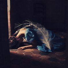 """The Weight of a Feather"" by Brooke Shaden.  Definitely one of my favorite photographers, her work is filled with beautiful light and colors, story, and symbolism."