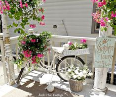 Junk Chic Cottage like the bike painted all white sure makes the flowers pop