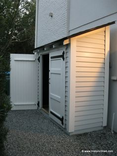 Small tool storage shed on the side of the house