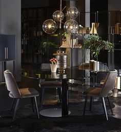 Oto,table with glass top and lacquered metal structure. Designed by Oscar & Gabriele Buratti for Gallotti&Radice. - Thea, chairs - Bolle, ceiling lamp - Drizzle, shelving system.