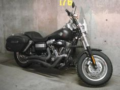 a 2009 Dyna Fat Bob with Vance and Hines pipes exact replica of my bike :).  Larry's Bike