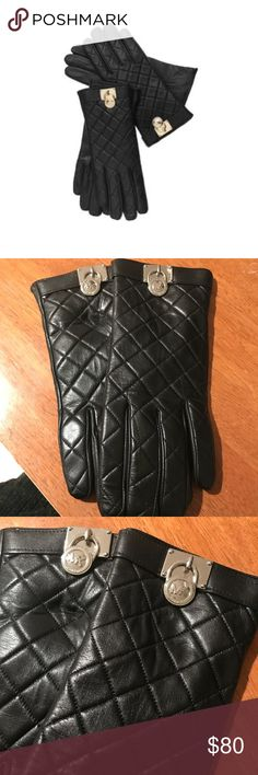 NWOT Michael Kors Leather Gloves NWOT Michael Kors Hamilton Lock gloves in black quilted leather in a size large. Perfect condition as they were never worn!  Have touch tips for cell phone use while wearing. Very classy and elegant. MICHAEL Michael Kors Accessories Gloves & Mittens