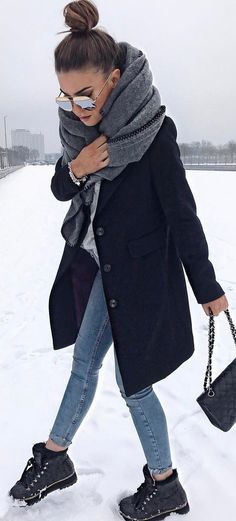 Cozy gray scarf and black coat over jeans.
