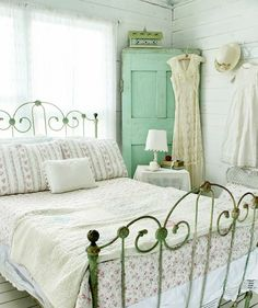 I don't like metal beds but this is a charming little bedroom.