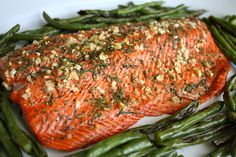 Rosemary and Garlic Roasted Salmon. 3 cloves Garlic 2 sprigs Rosemary, About 1 Tablespoon Chopped 2 pounds Salmon Fillet 1 Tablespoon Extra Virgin Olive Oil 2 pinches Sea Salt 1 pinch Ground Pepper 425 for Salmon Recipes, Fish Recipes, Seafood Recipes, Cooking Recipes, Healthy Recipes, Seafood Meals, Cooking Rice, Cooking Turkey, Delicious Recipes
