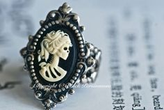 This ring features Miss Skeleton.    A delicate Miss Skeleton cameo has been set on a detailed vintage style setting, die struck in brass with