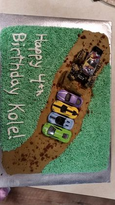 "Kole's 4th birthday dirty monster truck cake  I frosted the whole cake brown, and used the grass tip for green. The ""dirt"" on the path is crumbled cake. I also made the ramp using leftover cake."