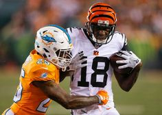 The Cincinnati Bengals defeated the Miami Dolphins, 22-7, in a Thursday Night Football game in Week 4 of the 2016 NFL season at Paul Brown Stadium.  -  Cincinnati Bengals wide receiver A.J. Green (18) runs the ball against Miami Dolphins cornerback Xavien Howard (25) during the first half of an NFL football game, Thursday, Sept. 29, 2016, in Cincinnati.