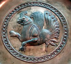 This copper plate is from Sasanid period. I took this shot in RezaAbbasi museum in Tehran.