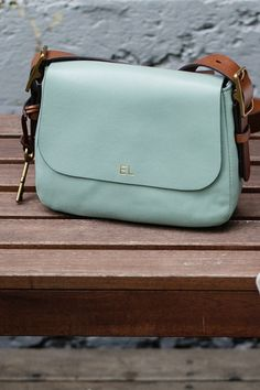 The everyday leather Harper Crossbody handbag in a pop of color with embossed initials. @emloughridge