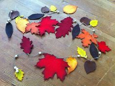 I don't think there is anything much prettier than autumn leaves.  Felt Leaf Garland Tutorial