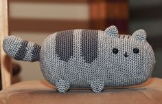 Pusheen the Cat by EmmasAnimalCreations published in Emma H's Ravelry Store.  This is a complimentary pattern.  Thank you, Emma.  It's adorable!